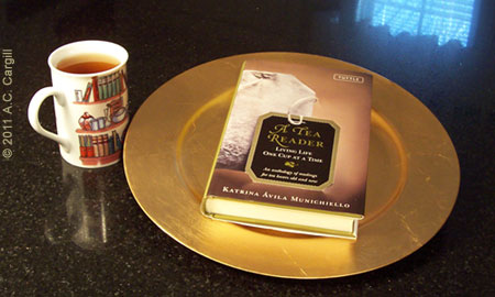 Serving up some tasty tea reading on a gold-colored platter