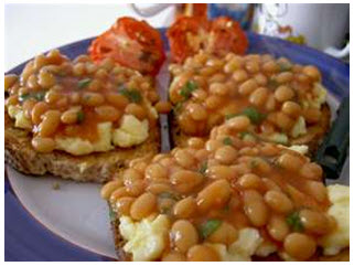 Baked beans with scrambled eggs on toast