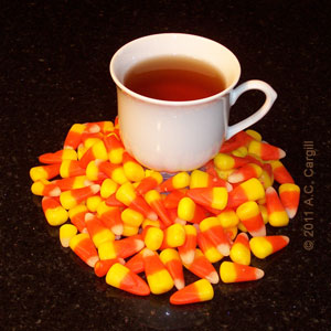 Tea sip - candy corn - tea sip - candy corn - ahhh!
