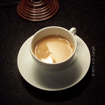 In the cup with milk and sweetener