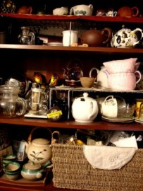 Shelves overflowing with tea and tea ware.