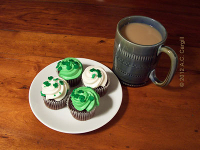 Chocolate cupcakes with green and white icing and shamrock sprinkles are perfect for your St. Patty's Day tea time