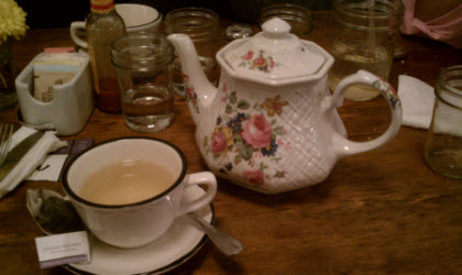 "One of the eclectic English-style teapots at ""tbsp."" (Sorry about the teabag!)"