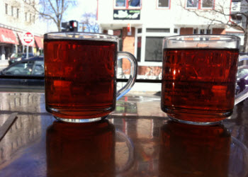 Two cups of Tealuxe tea watching the world go by (photo is mine)
