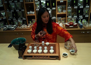"May King Tsang performing Gong Fu Tea Ceremony ""with a Dash of Milk"""