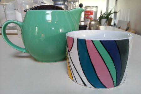 My borrowed teawares: a Bee House teapot and colourful little mug (photo is mine).