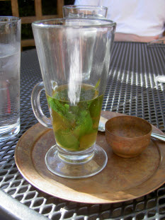 Moroccan mint tea served in a tall glass cup