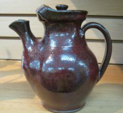 Teapot in maroon glaze