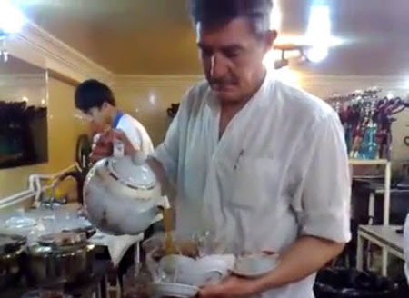 From an amazing video of a waiter in a tea house in Iran – click the photo to go to the YouTube page and watch.
