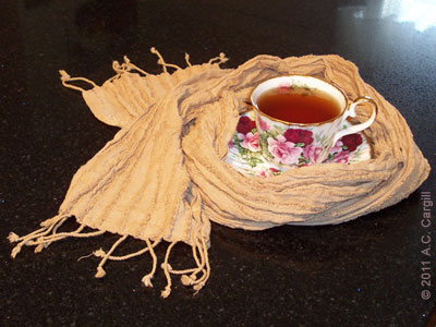 Even your teacups can sport some offbeat tea time fashion! (Tea dyed scarf from CrafTea Designs. Photo source: A.C. Cargill, all rights reserved)