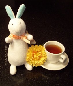 """Bob the Tea Bunny"" with one of his fave Fall flowers: a bright yellow Chrysanthemum! (Photo source: A.C. Cargill, all rights reserved)"