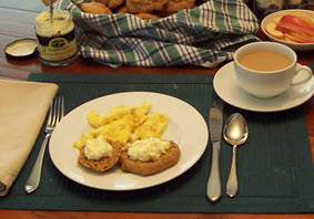 Clotted cream dollops on pumpkin spice scones add the right taste to tea time! (Photo source: A.C. Cargill, all rights reserved)