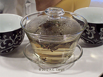 Tea soup in the making. A glass gaiwan lets you see all the action. (Photo source: A.C. Cargill, all rights reserved)