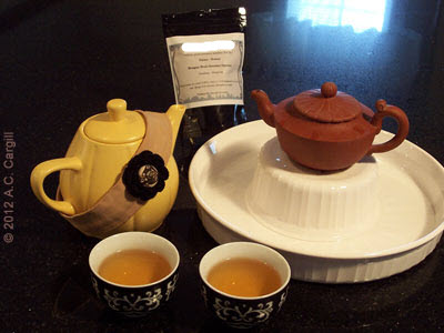 Little Yellow Teapot supervises while Yixing teapot 'Simplicity' steeps up a perfect Dragonwell. (Photo source: A.C. Cargill, all rights reserved)