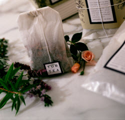 Tub Tea sachets — oversized tea bags filled with dried herbs, flowers, and citrus peels. (Source: screen capture from site)