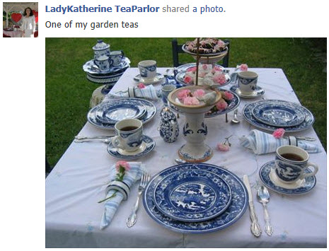 A tea time table set with blue transferware. (screen capture from Facebook)