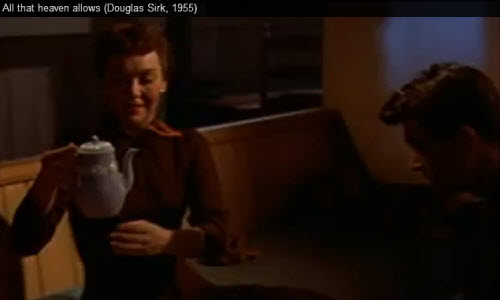 Cary Scott (Jane Wyman) holds the Wedgwood teapot pieced back together by Ron Kirby (Rock Hudson) as a symbol of their solidifying relationship. (Screen capture from site)