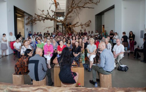 From Left: Cai's Interpreter, Cai Quo-Qiang, May King Tsang and Russell Storer, curator of QAGOMA, speaking at the Opening Weekend of Falling Back to Earth (Photographer: Brodie Standen, Image Courtesy: Queensland Art Gallery | Gallery of Modern Art)