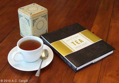 "Sipping Vanilla Comoro while leafing through ""The Harney & Sons Guide to Tea"" (Photo by A.C. Cargill, all rights reserved)"