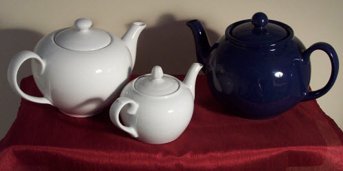 Even my teapots get in on the celebration, lining up for a red, white, and blue display! (Photo by A.C. Cargill, all rights reserved)