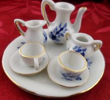 Tiny Tea Cup And Saucer Set with Teapot Creamer Sugar Bowl (screen capture from site)