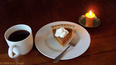 A strong cuppa Assam, a dollop of fresh whipped cream, and a small lit candle make that pumpkin pie even more comforting. (Photo by A.C. Cargill, all rights reserved)